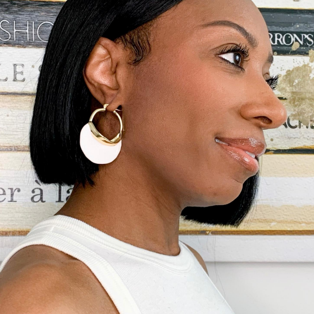 white and gold statement earrings
